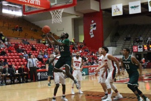 Tevin Findlay, guard for the University of Wisconsin-Green Bay, drives into the lane for layup in the second half of Youngstown State University's loss on Saturday.