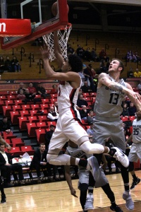 Youngstown State University's Devin Haygood avoids a block attempt as he drives for a layup.