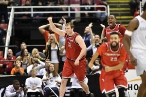 YSU center Jorden Kaufman raises his fist after scoring the game-winning basket against Oakland.