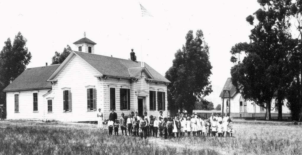 San Ramon Grammar School with the San Ramon Methodist Church  in the background, c. 1900.