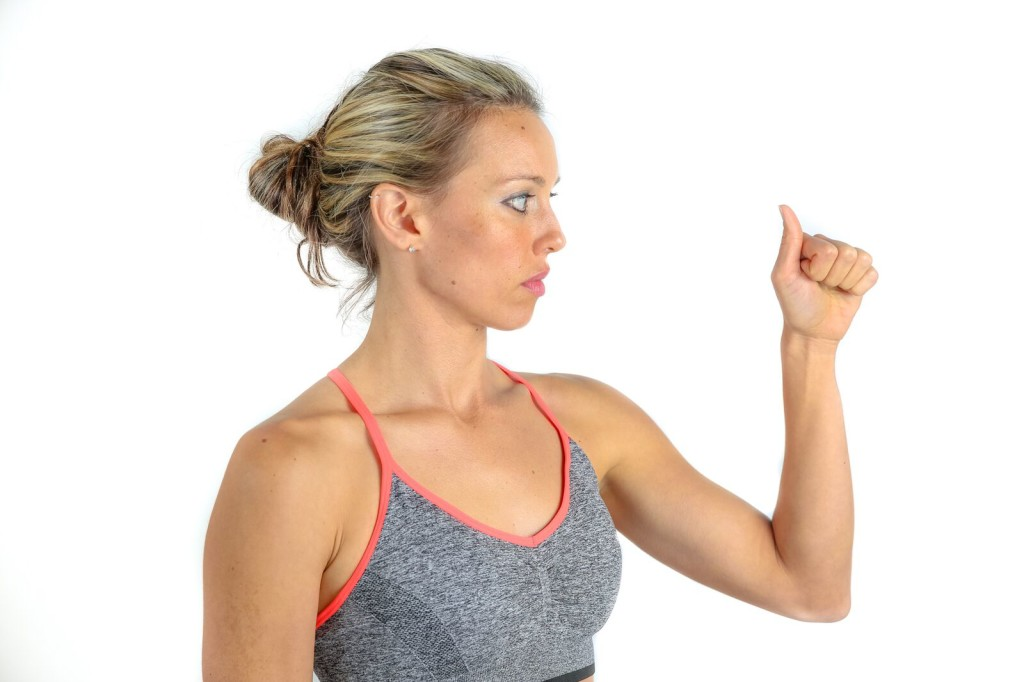 Making a fist with tendon gliding exercises for carpal tunnel syndrome