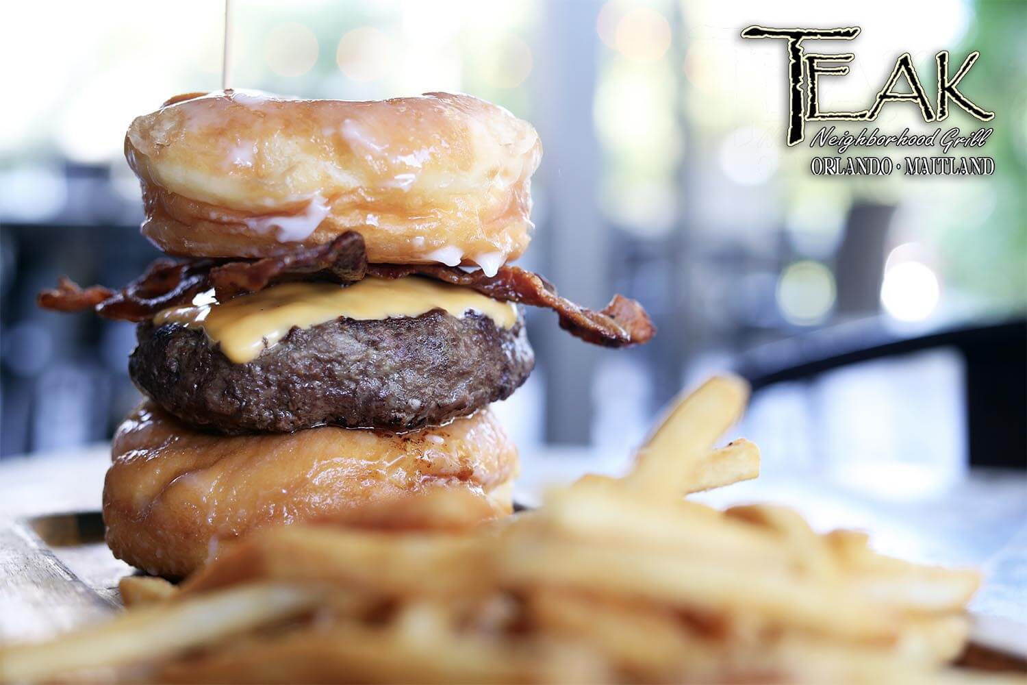 Donut Burger with Bacon and Cheese and side of fries