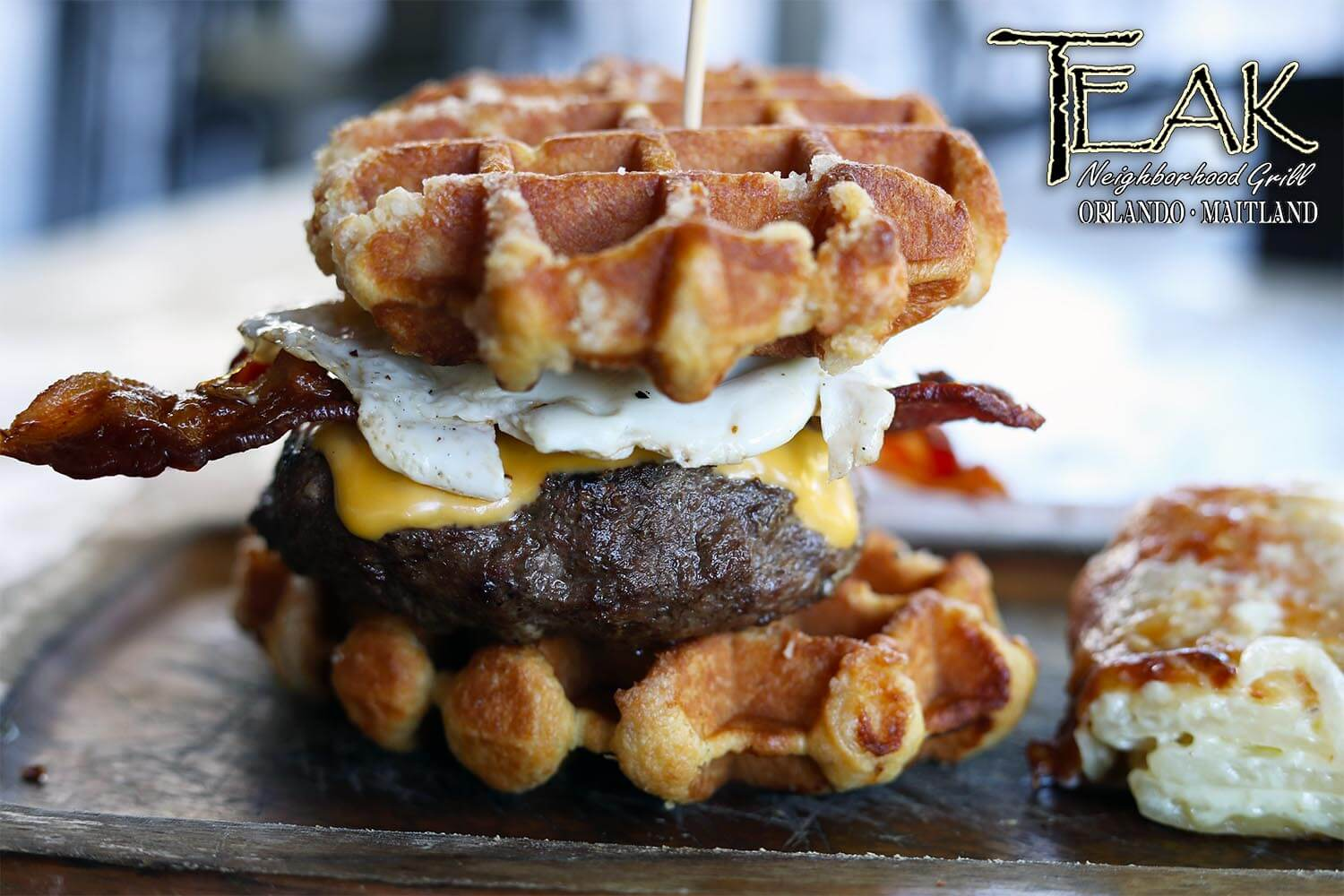 The Waffle Burger with bacon, eggs, and American cheese