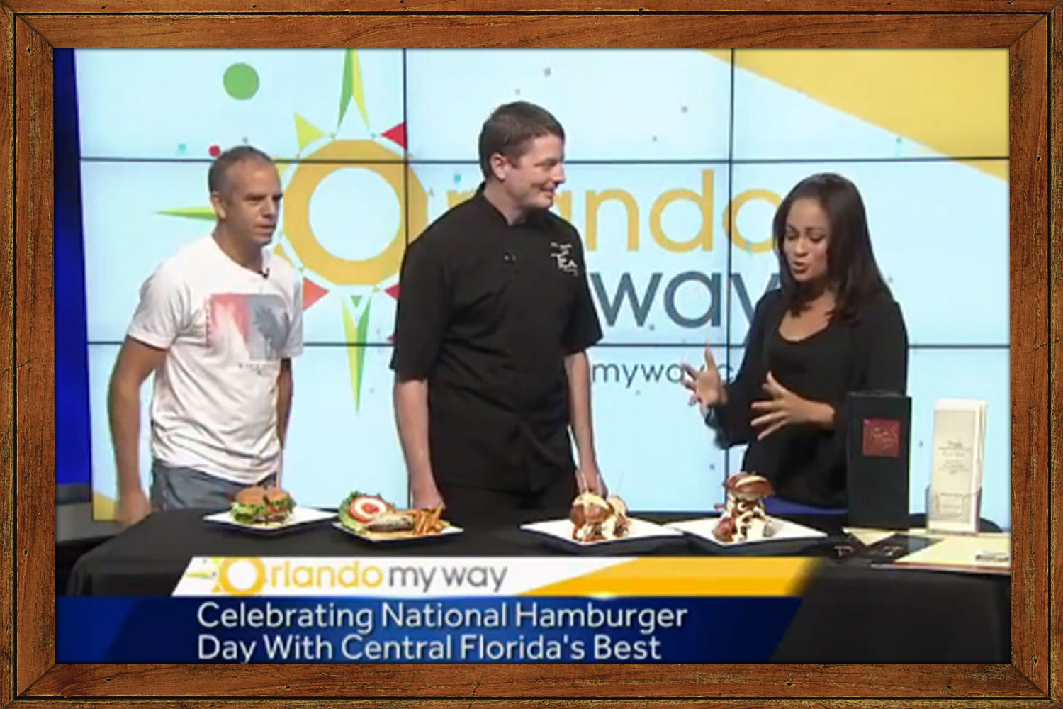 Chef Phillip with News Anchor from Wesh 2 For National Burger Day
