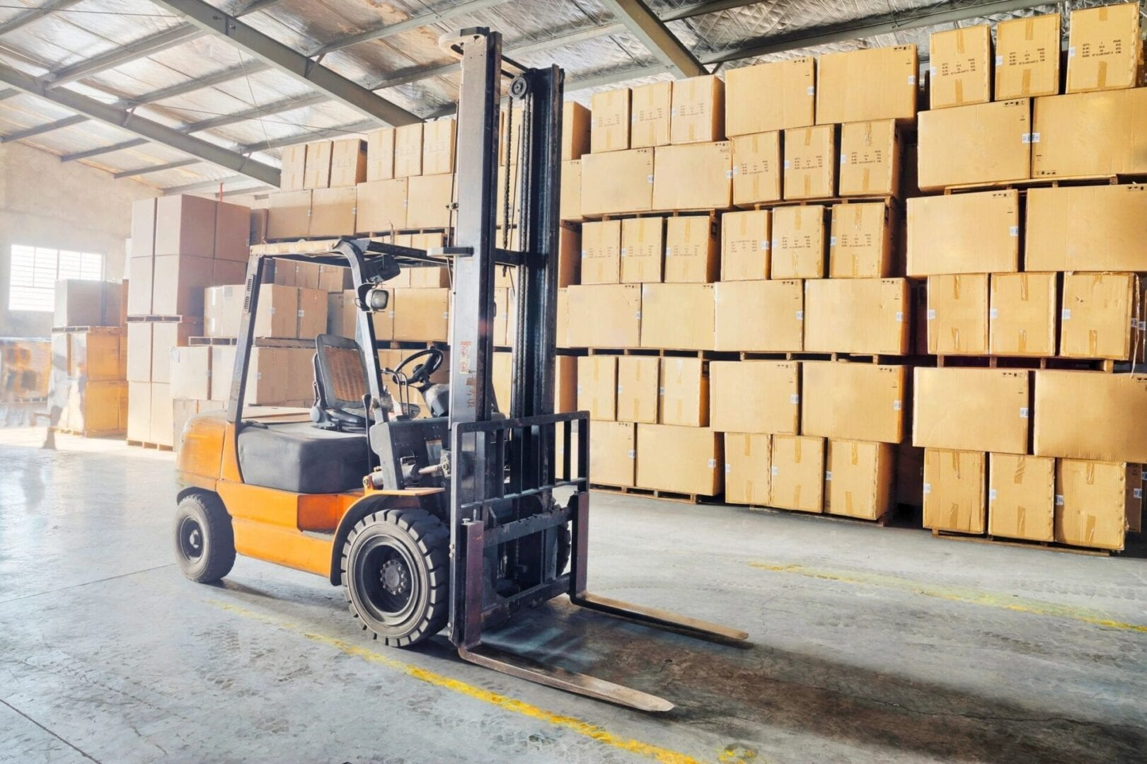 Forklift facilitating warehouse storage services in Maine