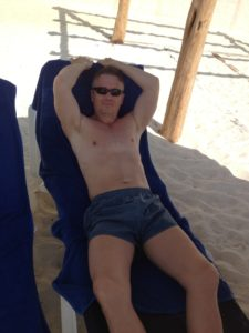 Todd relaxing on the beach in Cancun