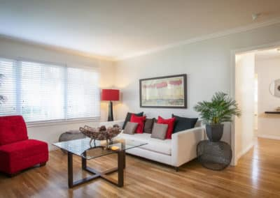 Living room with furniture and red and black decor