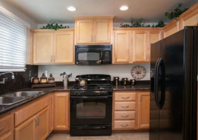 Kitchen with black countertops and appliances