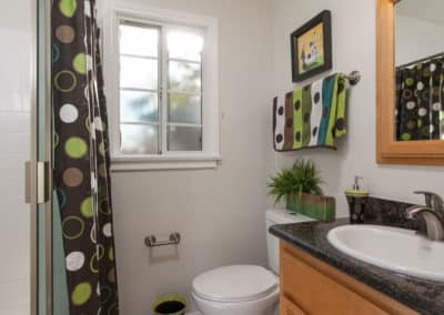 Bathroom sink, toilet, and shower curtain