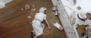 woman lying on the ground as if dead