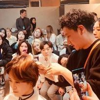 Shinichi Takahashi, current President of Hikari Japan, champion hairdresser, and master scissor craftsmen, demonstrating cutting techniques in Taiwan 2019.