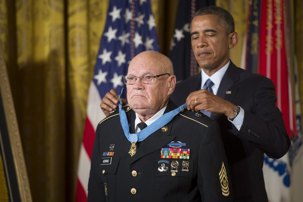 """President Barack Obama bestows the Medal of Honor to retired Command Sgt. Maj. Bennie G. Adkins in the East Room of the White House, Sept. 15, 2014.  Adkins distinguished himself during 38 hours of close-combat fighting against enemy forces on March 9 to 12, 1966.  At that time, then-Sgt. 1st Class Adkins was serving as an Intelligence Sergeant with 5th Special Forces Group, 1st Special Forces at Camp """"A Shau"""", in the Republic of Vietnam.  During the 38-hour battle and 48-hours of escape and evasion, Adkins fought with mortars, machine guns, recoilless rifles, small arms, and hand grenades, killing an estimated 135 - 175 of the enemy and sustaining 18 different wounds.  (U.S. Army photo by Staff Sgt. Bernardo Fuller/Released)"""