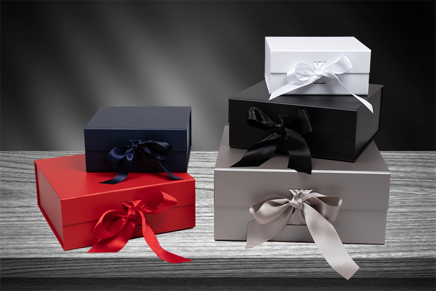 Magnetic lid gift boxes with ribbon tied closure