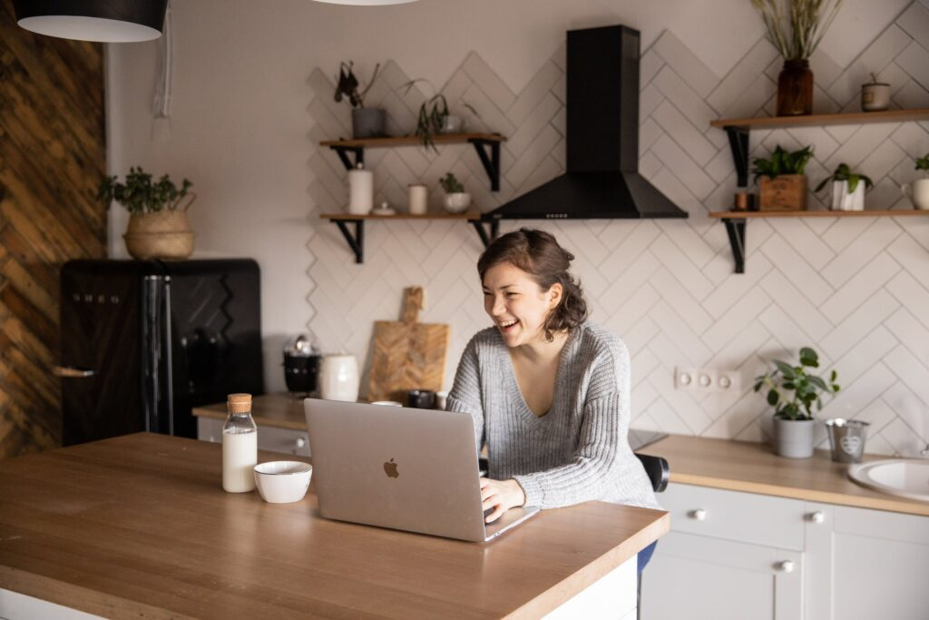 Woman video chatting in her kitchen