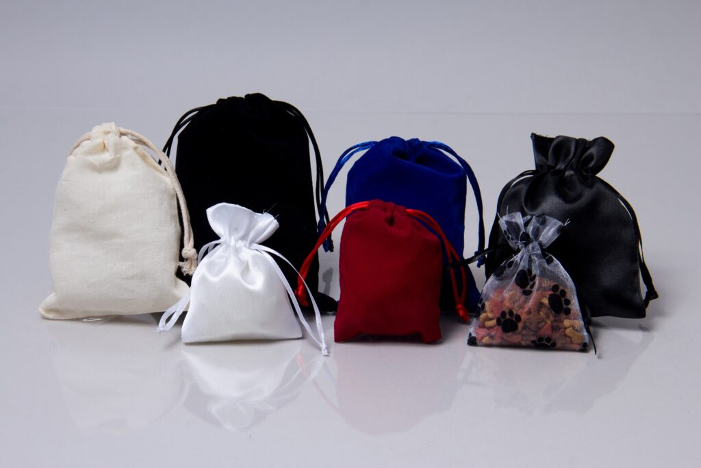 A collection of drawstring pouch bags in different colors and styles