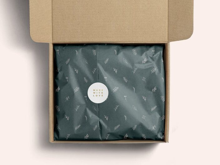 Box with tissue paper inside sealed with a label