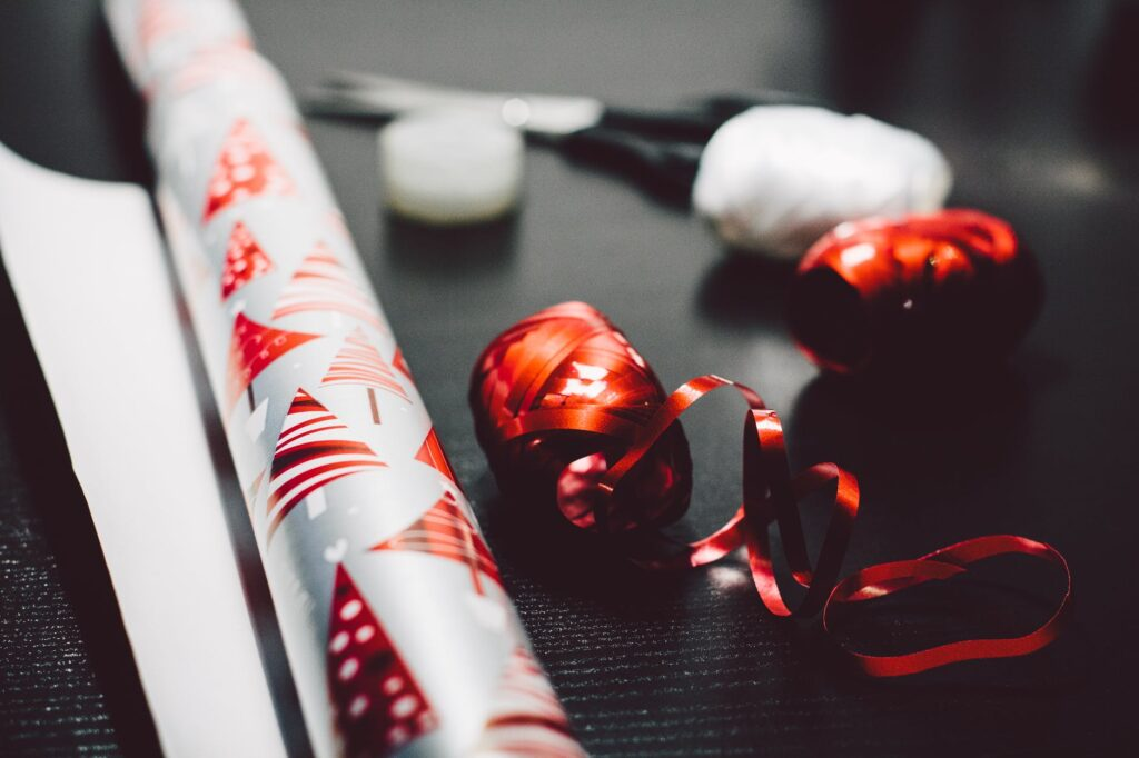 Roll of gift wrap and rolls of ribbon