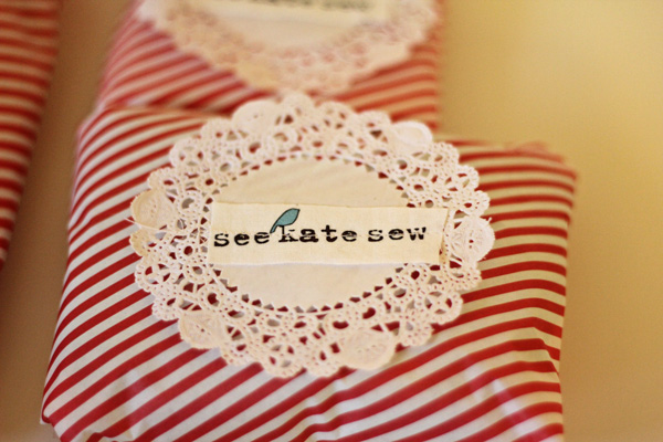 Item wrapped in tissue paper and sealed with a logo doily.