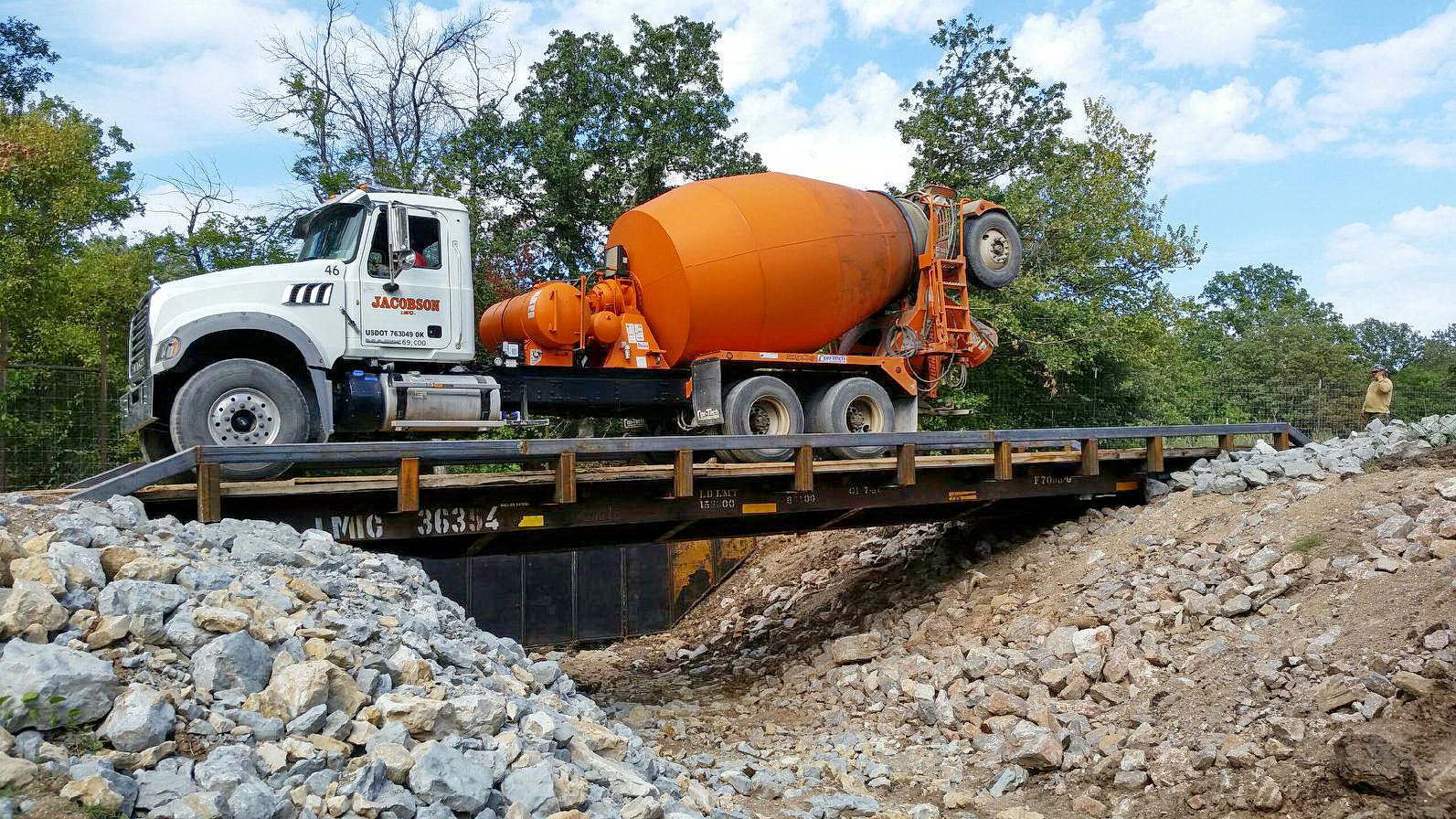 Typical bridge made from a railroad car can easily carry an 89,000-pound ready-mix truck.