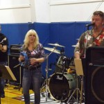 A band plays at a packing event