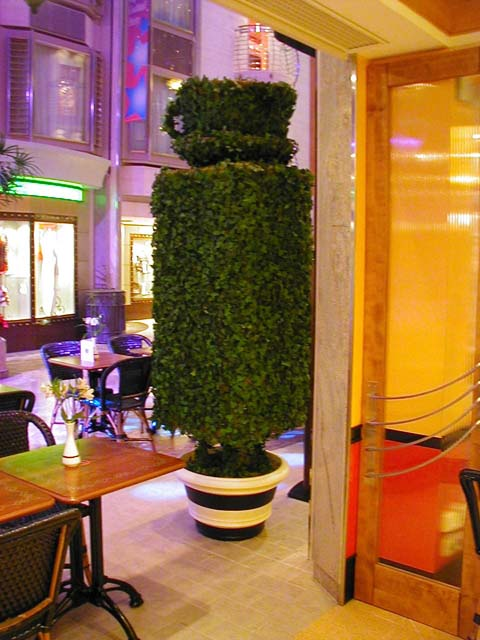 Close-up of 8 ft Topiary in Front of Cafe Promenade