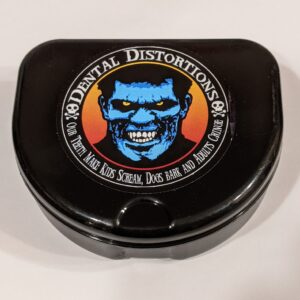 Black case to store Dental Distortion FX Fangs
