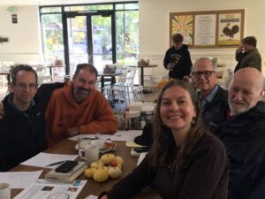 Photos of physicians at a cafe for a Joy of Medicine Peer Group event