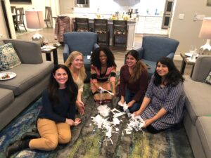 Photo of physicians making paper snowflakes at Joy of Medicine Peer Group meetup