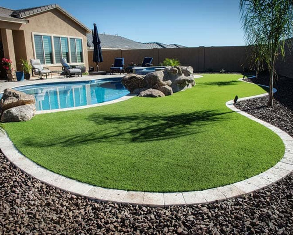 turf by swimming pool