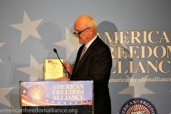 Phil Haney hold Award