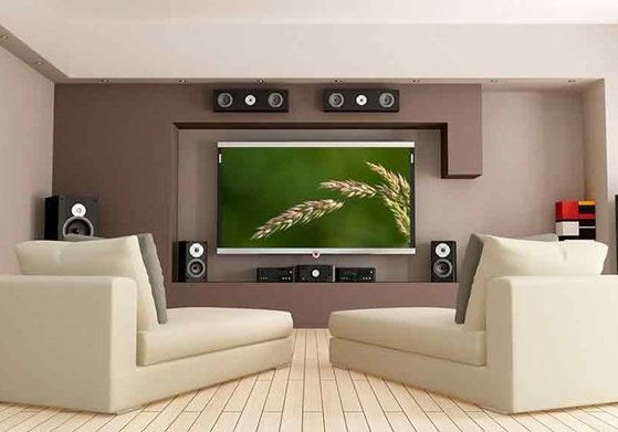 a lounge room with a big tv and home theatre system