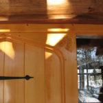 Pine cone carving plank door