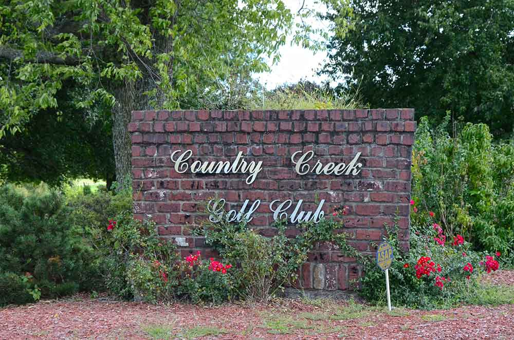 The-Rock-at-Country-Creek-Golf-Club,-Pleasant-Hill,-MO-Sign