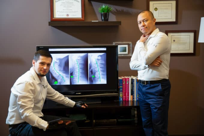 Chiropractors discussing xrays from a car accident injury