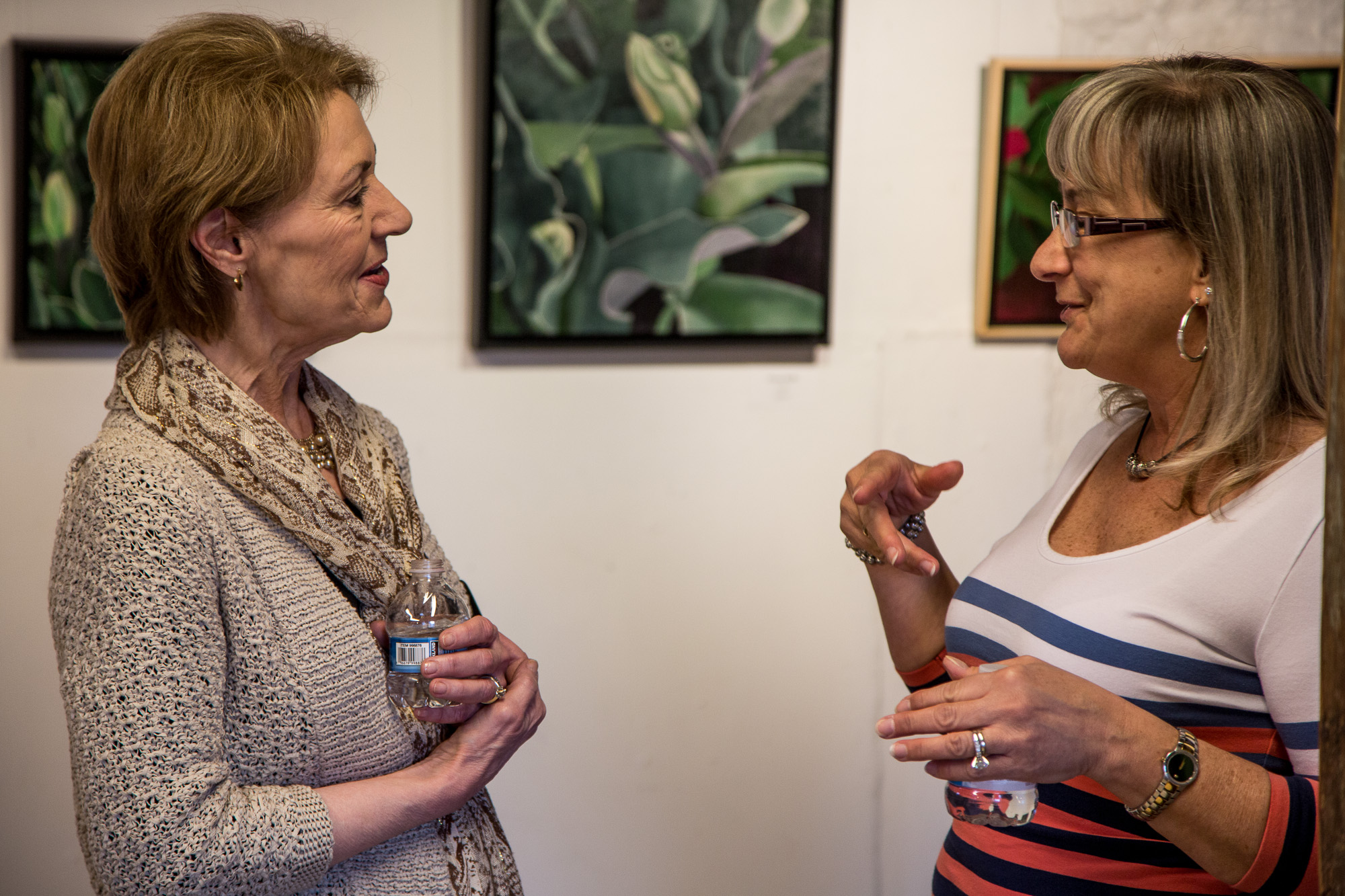 Kathy Guzman with a visitor in her Member's Gallery exhibit