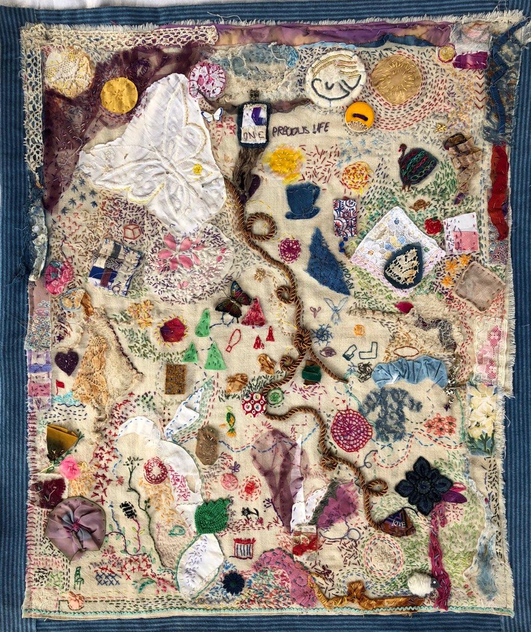 One Precious Life, fiber art by Kay Portmess (MG: July 2020)