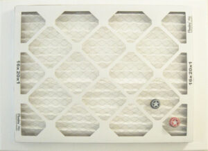 Air Filter Reverse Side with Placed Beer Bottle Caps #2, Decorated air filter on Canvas by John Nichols, 18in x 24in, NFS (October 2021)