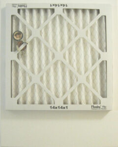 Air Filter Reverse Side with a Placed Pin Figure #1, Assemblage by John Nichols, 20in x 16in, $300 (October 2021)