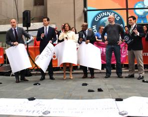 The Today Show Team Helps Lincoln Peirce break the World Record for the Longest Cartoon Strip by a Team.