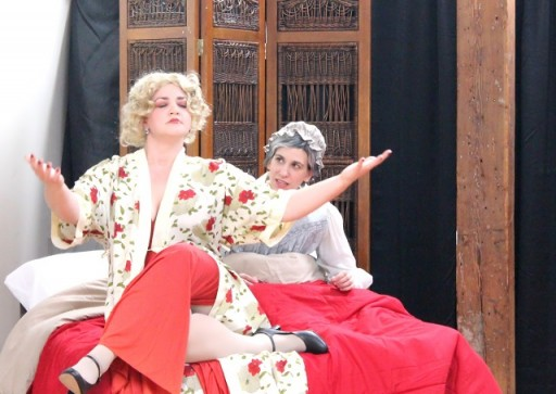 Mae West (Brigette Estola, left) attempts to commune with the spirit of Leo Tolstoy to help give peace to his widow, Sophia (Kirsten Egenes) in Bad Quarto Productions' 2017 production of Anna Karenina Lives! By Germaine Shames. Directed by Tony Tambasco. Costumes by Joanne Famiglietti. Photo by James M. Smith.