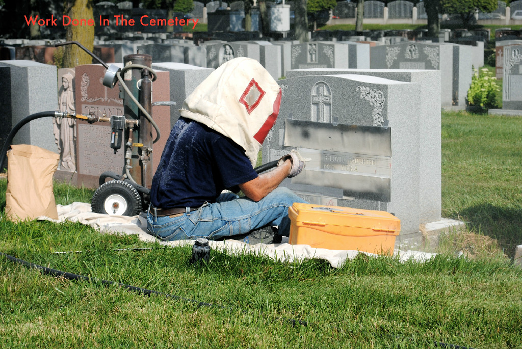 One of our skilled craftsman adding lettering to an existing monument.