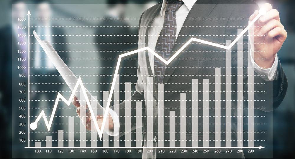 Businessman drawing business chart