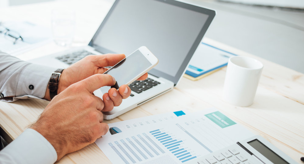 financial plan | picture of man calculating numbers