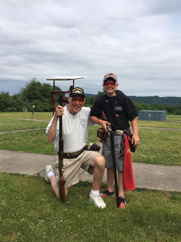 """Eleven-year-old Joseph Breck IV broke his first 100 during the class singles at the Pennsylvania State Shoot. Bob Mitchell is his squadmate and mentor. According to ATA Alternate Delegate Steve Ross (not pictured), """"It's a bit of a blend of old and new. Bob has over 575,000 singles targets, and Joe has 7,000. But the kid loves to shoot with the 'old man.' """""""