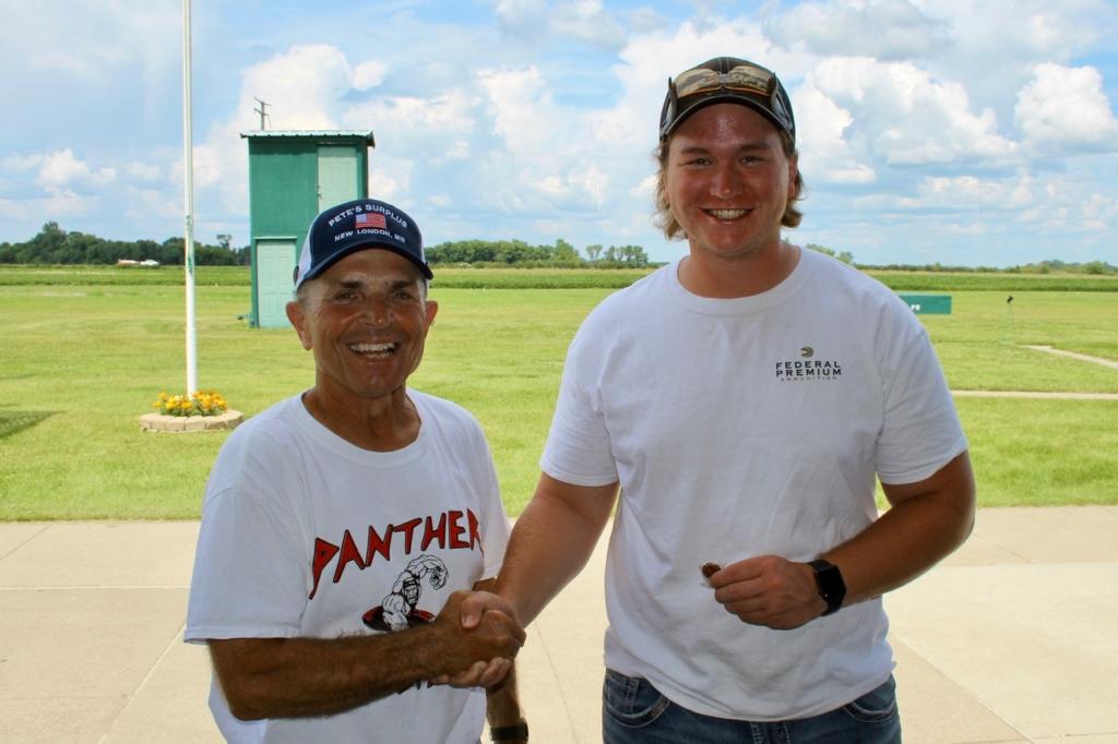 ATA Delegate Paul Cyr presented Colton Sherman his 27-yard pin after a 96 at the ATA Central Zone Shoot.