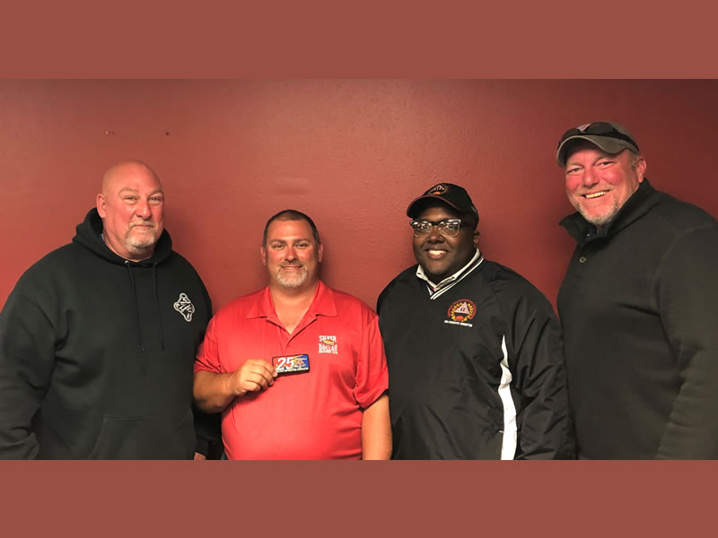 New shooter Dan Boisclair (second from left) received his 25-straight patch from Ohio ATA Delegate Michael Blair, ATA Central Zone Vice President Darryl Hayes and Indiana Delegate Jason Barnett.