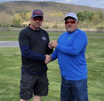 Donald O'Conner received his 100 straight pin from ATA Delegate Brian James. O'Conner broke his first perfect century during the Mug O' Money Shoot at Valley G&CC.