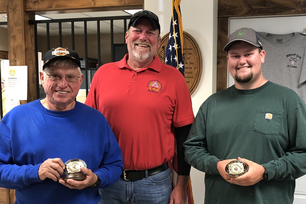 Indiana ATA Delegate Jason Barnett (middle) congratulated Bobby Hubble on winning the handicap and Daniel Williams on topping the singles, doubles and all-around at the state central zone shoot.
