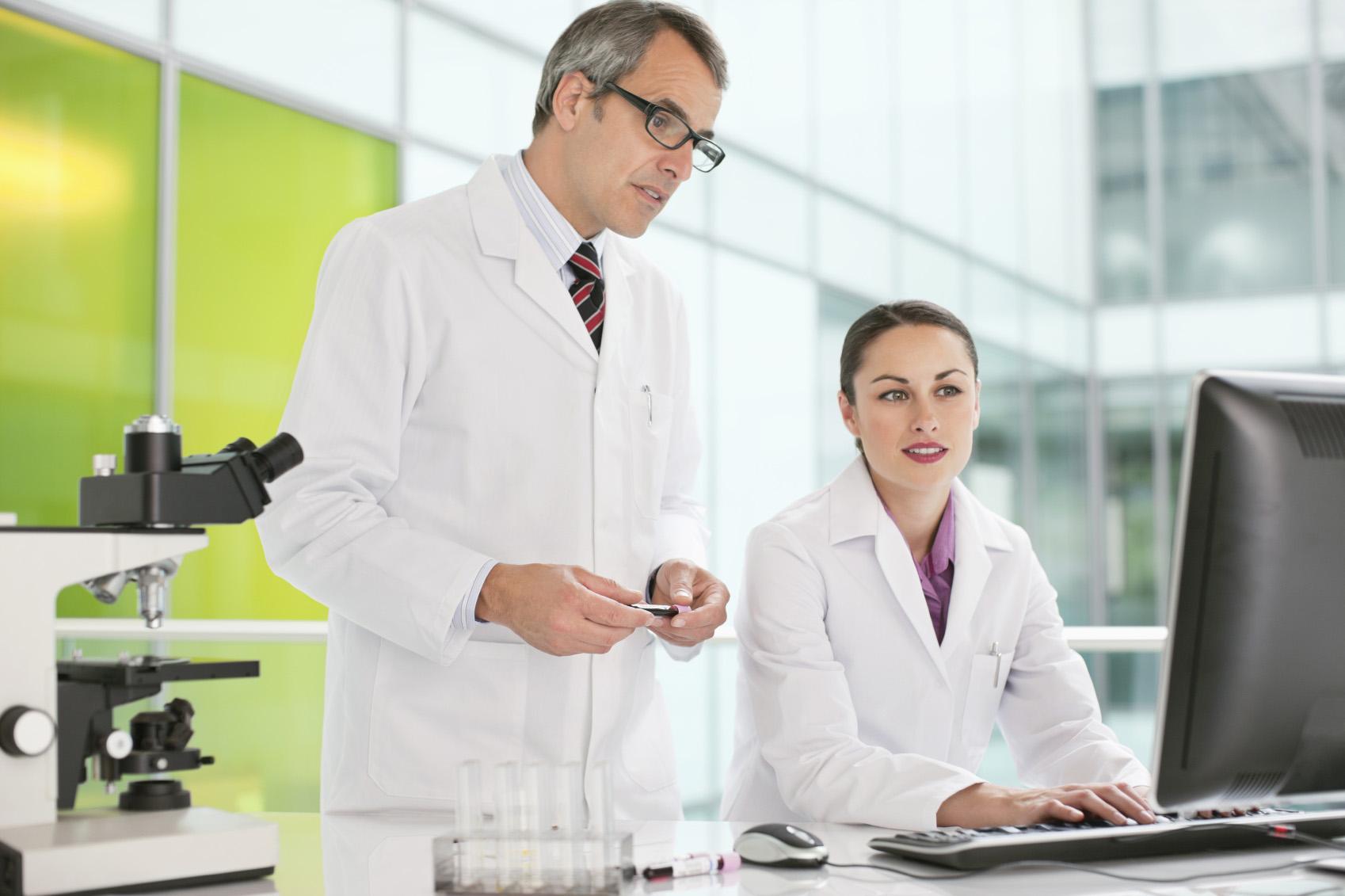 Laboratory technicians using the CGM LABDAQ laboratory information system.