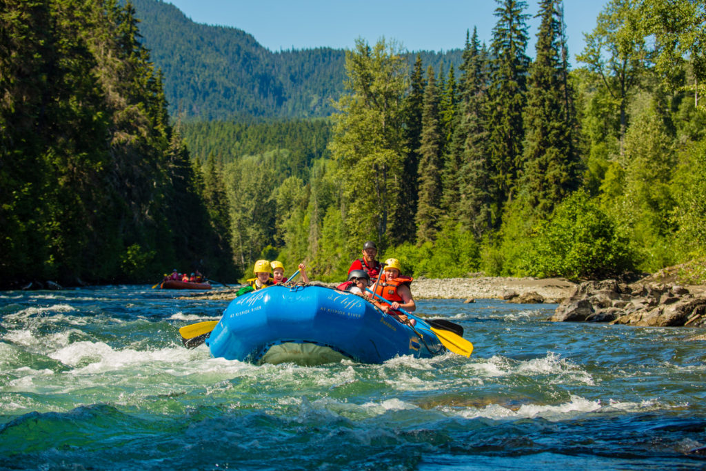 Riding rapids in a dinghy on the Kispiox Rivier